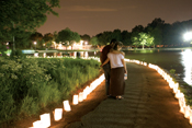 Couple looking at luminaries on Relay track