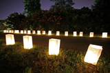 A trail of luminaries lights the way